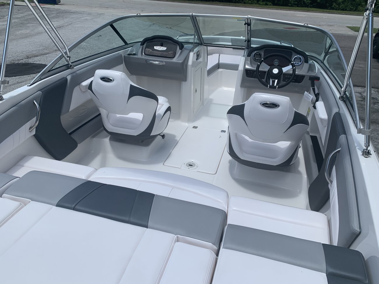 A dual console boat is typically one that was designed for salt water fishing and has the console split around a center walk thru to the bow.  The helm is usually starboard while there is passenger seating to port.